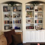 Custom cabinets and bookshelves in white